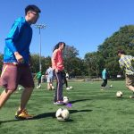 students doing soccer drills
