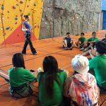 preparing to do indoor rock climbing