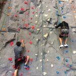 two people on a rock climbing wall