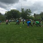 summer program students playing outdoor sports